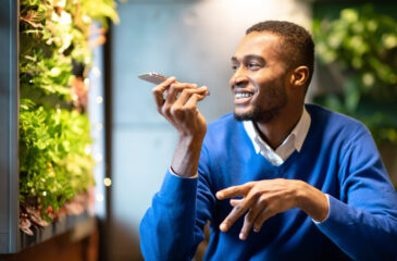 Black young man talking into cell phone